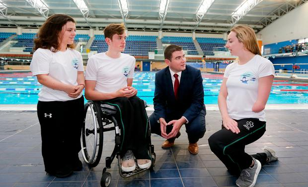 From left to right, Junior Sports Minister Brendan Griffin speaks with athletes Nicole Turner, Patrick Flanagan and Ellen at the launch of the 2018 Para Swimming European Championships. Photo: Gerry Mooney