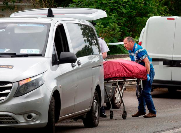 A body is removed from the scene of a fire in Tully East, Kildare. Photo: Tony Gavin