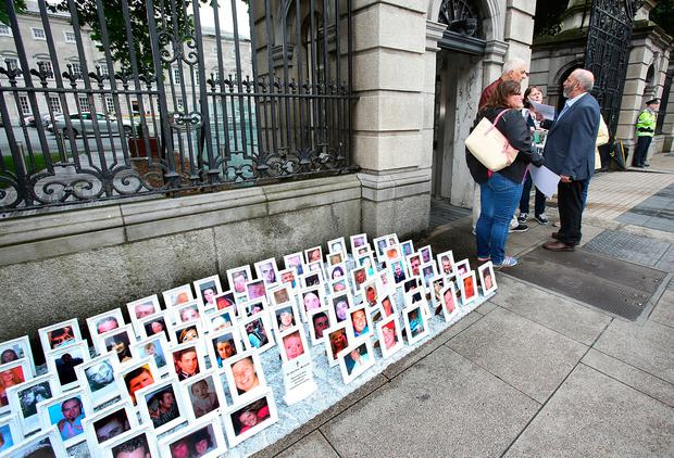 Leo Lieghio, Clondalkin, father of 16-year-old Marsia Lieghio who lost her life in a hit-and-run in October 2005, and other victims' relatives talk with Danny Healy-Rae at Leinster House. Photo: Tom Burke