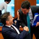 Dutch Finance Minister and Eurogroup President Jeroen Dijsselbloem greets Irish Finance Minister Paschal Donohoe during a Eurozone finance ministers meeting in Brussels. REUTERS/Francois Lenoir