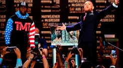 Floyd Mayweather and Conor McGregor faceoff on stage at the Staples Center, Los Angeles last night. Photo: Getty Images