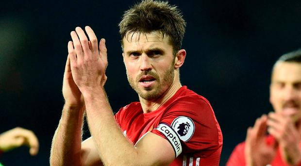 Michael Carrick has replaced Wayne Rooney as Manchester United captain. Photo: Oli Scarff