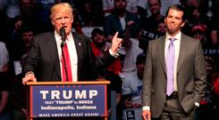Republican presidential candidate Donald Trump introduces his son Donald Trump Jr. as he addresses the crowd during a campaign rally at the Indiana Farmers Coliseum on April 27, 2016 in Indianapolis, Indiana