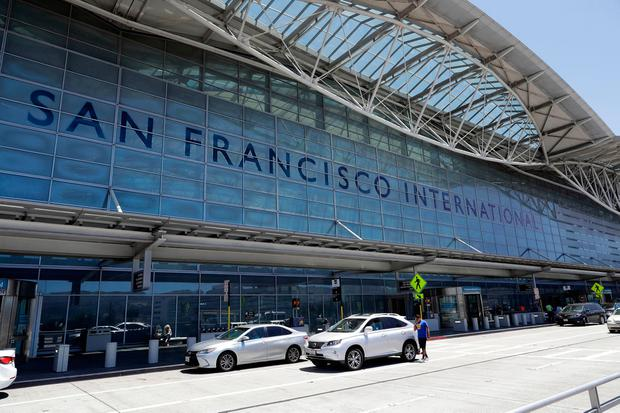 Vehicles wait outside the international terminal at San Francisco International Airport Tuesday, July 11, 2017, in San Francisco