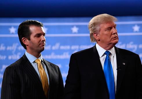 Donald Trump (R) stands with his son Donald Trump Jr. Credit: JEWEL SAMAD/AFP/Getty Images