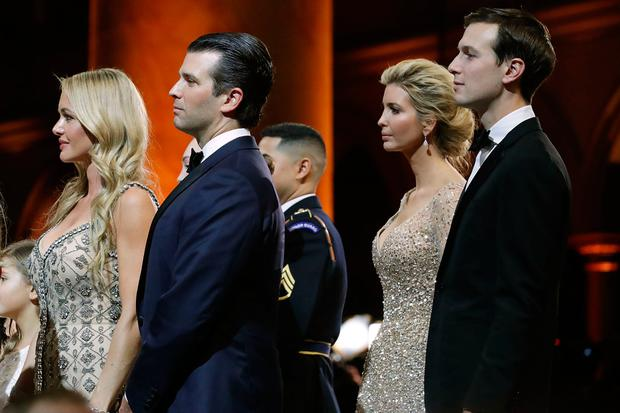 (L-R) Vanessa Trump and her husband Donald Trump, Jr. and Ivanka Trump and her husband Jared Kushner watch U.S. President Donald Trump cut a cake during the inaugural Armed Services Ball at the National Building Museum January 20, 2017 in Washington, DC