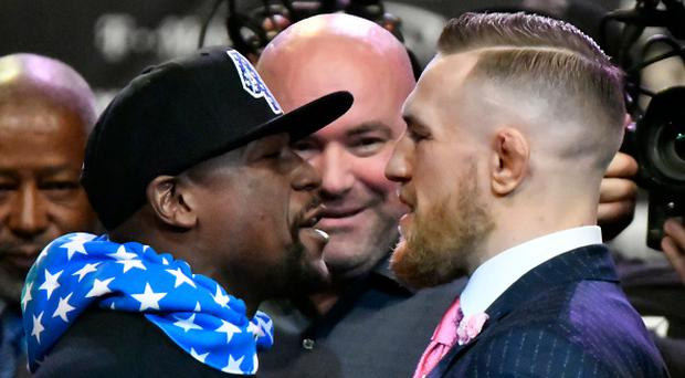 Floyd Mayweather and Conor McGregor went at it once again on day two of their publicity tour / AFP PHOTO / Gene Blevins