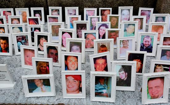 Photos of some of victims who lost their lives in road crashes which were displaye at the vigil organised by the Irish Road Victims' Association Pic Tom Burke