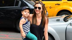 Miranda Kerr wearing the Chloe Susanna boots with son Flynn Bloom in New York City. (Photo by James Devaney/FilmMagic)