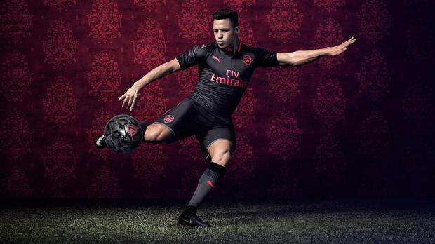 0ca120d3c Alexis Sanchez launches Arsenal s new black and pink third kit as ...