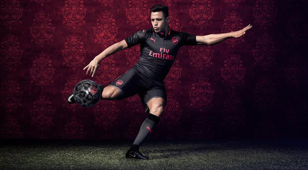 Alexis Sanchez models Arsenal's new jet black kit. CREDIT: PUMA