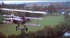 A scene from 'The Blue Max' in which a German triplane approaches the bridge