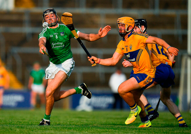 Colin Ryan of Limerick in action against Jason McCarthy of Clare. Photo by Brendan Moran/Sportsfile