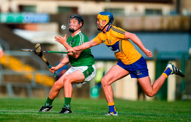 Peter Casey of Limerick in action against Dara Walsh of Clare. Photo by Brendan Moran/Sportsfile