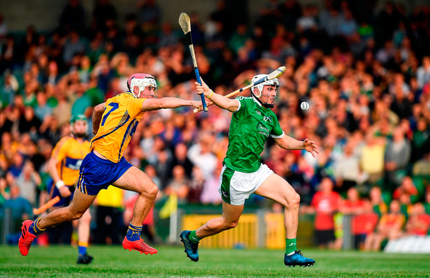 Aaron Gillane of Limerick in action against Michael Moloney of Clare. Photo by Brendan Moran/Sportsfile