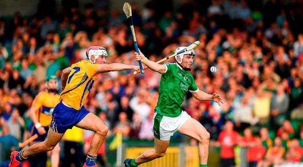 Aaron Gillane of Limerick in action against Michael Moloney of Clare during the Bord Gais Energy Munster GAA Hurling Under 21 Championship Semi-Final match between Limerick and Clare at the Gaelic Grounds in Limerick. Photo by Brendan Moran/Sportsfile