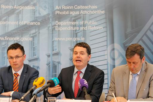 Minister of State of Public Procurement, Patrick O'Donovan TD, the Minister of Finance & Public Expenditure and Reform, Paschal Donohoe TD and Minister for State for Financial Services and Insurance, Micheal Darcy TD, pictured addressing the media on the Summer Economic Statement 2017. Photo: Stephen Collins/Collins