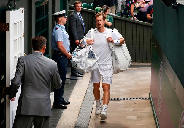 Andy Murray heads for the locker room after losing his quarter-final against Sam Querrey. Pic: Reuters