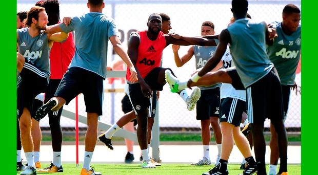 Romelo Lukaku of Manchester United stretches with teammates during training in the States