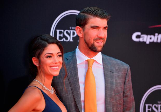 Olympic swimmer Michael Phelps (R) and model Nicole Johnson attend The 2017 ESPYS at Microsoft Theater on July 12, 2017 in Los Angeles, California. (Photo by Matt Winkelmeyer/Getty Images)