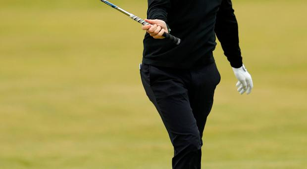 Ireland's Rory McIlroy reacts during the first round