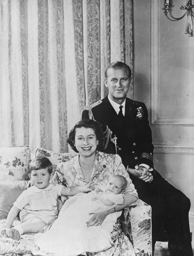 Portrait of Princess Elizabeth and Prince Philip with their baby daughter Princess Anne and son Prince Charles, following the baby's christening at Buckingham Palace, London, October 21st 1950. (Photo by Central Press/Hulton Archive/Getty Images)