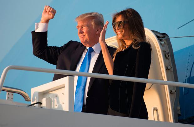 US President Donald Trump and First Lady Melania Trump board Air Force One prior to departure from Andrews Air Force Base in Maryland, July 12, 2017, as they travel to Paris, France for Bastille Day. / AFP PHOTO / SAUL LOEBSAUL LOEB/AFP/Getty Images