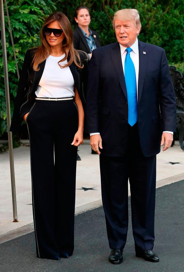 U.S. President Donald Trump and his wife first lady Melania Trump walk to Marine One while departing from the White House on July 12, 2017