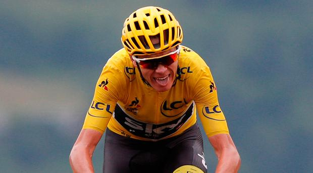 Britain's Chris Froome, wearing the overall leader's yellow jersey crosses the finish line during the twelfth stage of the Tour de France cycling race over 214.5 kilometers (133.3 miles) with start in Pau and finish in Peyragudes, France,Thursday, July 13, 2017. (AP Photo/Christophe Ena)
