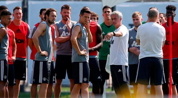 Manchester United's Jose Mourinho (C-R) directs training in LA. REUTERS/Lucy Nicholson