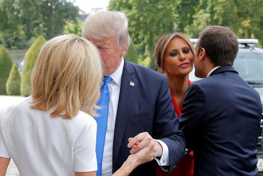 French President Emmanuel Macron (R) greets U.S. First Lady Melania Trump while his wife Brigitte Macron (L) welcomes U.S. President Donald Trump at Les Invalides museum in Paris, France, July 13, 2017. Photo: REUTERS/Michel Euler/Pool