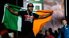 Floyd Mayweather with an Irish flag in the press conference with Conor McGregor in Toronto. Photo: AP