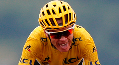 Britain's Chris Froome, wearing the overall leader's yellow jersey crosses the finish line during the twelfth stage of the Tour de France cycling race over 214.5 kilometers (133.3 miles) with start in Pau and finish in Peyragudes, France. Photo: AP