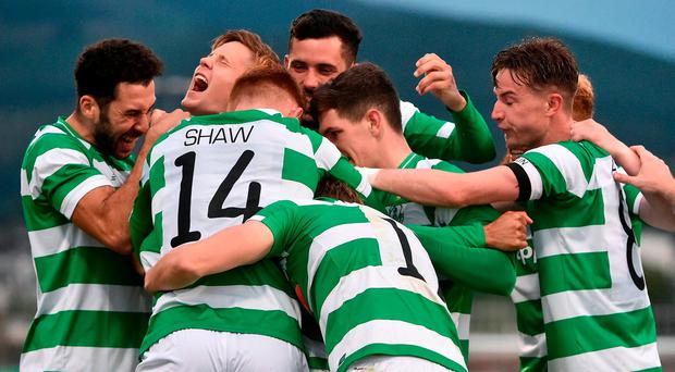 Graham Burke, hidden, of Shamrock Rovers celebrates after scoring his side's first goal with teammates Luke Byrne, David Webster, Trevor Clarke, Gary Shaw and Ronan Finn during the UEFA Europa League Second Qualifying Round First Leg match between Shamrock Rovers and Mlada Boleslav at Tallaght Stadium in Tallaght, Co Dublin. Photo by David Maher/Sportsfile