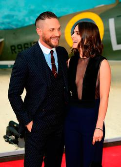 Tom Hardy and Charlotte Riley (right) attending the Dunkirk world premiere at the Odeon Leicester Square, London. PRESS ASSOCIATION Photo. Picture date: Thursday July 13, 2017. See PA story SHOWBIZ Dunkirk. Photo credit should read: Ian West/PA Wire