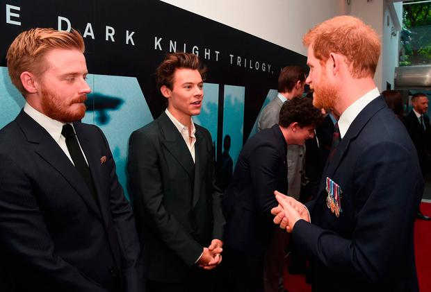 Prince Harry (right) shakes hands meets Harry Styles and Jack Lowden (left) as he attends the world premiere of Christopher Nolan's epic Second World War movie Dunkirk at the Odeon Leicester Square in London Credit: Eamonn M McCormack/PA Wire
