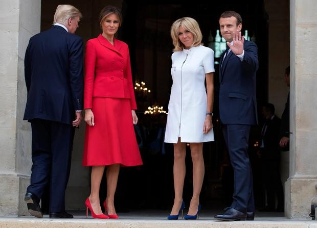French President Emmanuel Macron (R) and his wife Brigitte pose with U.S. First Lady Melania Trump and U.S President Donald Trump (L) at Les Invalides museum in Paris, France, July 13, 2017. REUTERS/Ian Langsdon/Pool