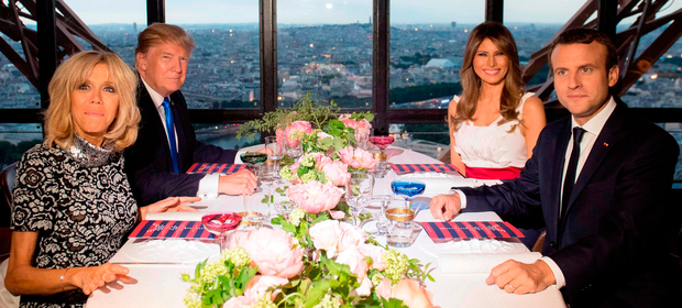 French President Emmanuel Macron, his wife Brigitte, US President Donald Trump and US First Lady Melania at a dinner at Le Jules Verne Restaurant in the Eiffel Tower as part of US president's 24-hour trip to Paris. Photo: Getty Images