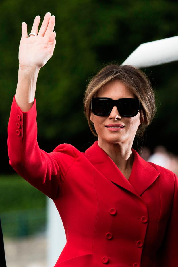 US First Lady Melania Trump waves after a boat trip down the River Seine in Paris, Thursday, July 13, 2017