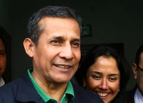 Peru's former President Ollanta Humala and former first lady Nadine Heredia leave the Nationalist Party headquarters in Lima