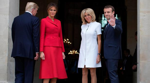 French President Emmanuel Macron (R) and his wife Brigitte pose with U.S. First Lady Melania Trump and U.S President Donald Trump (L) at Les Invalides museum in Paris. REUTERS/Ian Langsdon/Pool