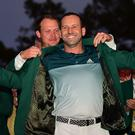 AUGUSTA, GA - APRIL 09: Danny Willett of England presents Sergio Garcia of Spain with the Green Jacket after Garcia won in a playoff during the final round of the 2017 Masters Tournament at Augusta National Golf Club on April 9, 2017 in Augusta, Georgia. (Photo by Harry How/Getty Images)
