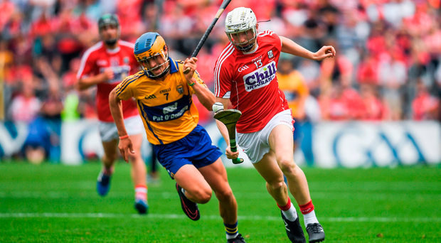 Evan Sheehan of Cork in action against Aidan McCarthy of Clare during the Electric Ireland Munster GAA Hurling Minor Championship Final. Photo: Brendan Moran/Sportsfile