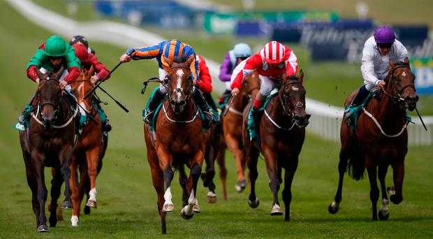 Clemmie, with Ryan Moore up (blue/orange) on the way to winning The Duchess Of Cambridge Stakes at Newmarket. Photo by Alan Crowhurst/Getty Images