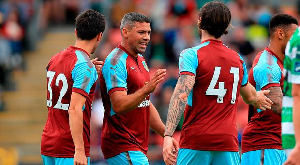 Burnley's Jonathan Walters (centre) celebrates scoring the first goal of the game with Jack Cork and Aiden O'Neill during the Pre-Season Friendly match at the Tallaght Stadium, Dublin. PRESS ASSOCIATION Photo. Picture date: Friday July 14, 2017. See PA story SOCCER Shamrock. Photo credit should read: Donall Farmer/PA Wire.