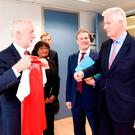 British Labour leader Jeremy Corbyn giving the EU's chief negotiator Michel Barnier an Arsenal shirt ahead of a meeting in Brussels Photo: Jennifer Jacquemart/PA