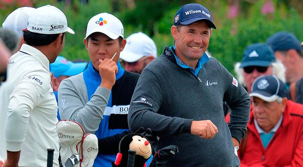 Pádraig Harrington shares a joke on the fifth tee during day two of the Scottish Open at Dundonald Links. Photo credit: Mark Runnacles/PA Wire.