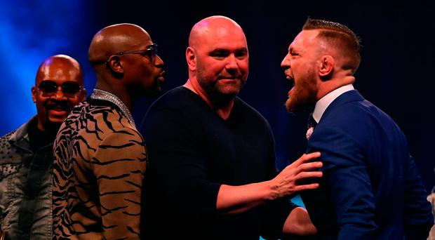 LONDON, ENGLAND - JULY 14: Dana White splits Floyd Mayweather Jr. and Conor McGregor apart during the Floyd Mayweather Jr. v Conor McGregor World Press Tour at SSE Arena on July 14, 2017 in London, England. (Photo by Matthew Lewis/Getty Images)