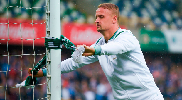 Leigh Griffiths tied a Celtic scarf to a goalpost after the match at Windsor Park. Photo by David Fitzgerald/Sportsfile