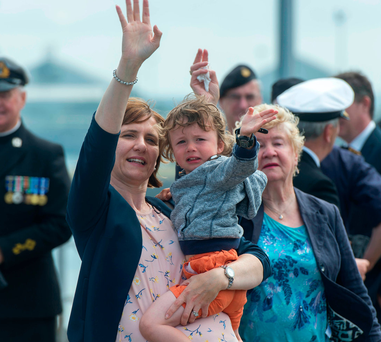 Carol Linehan with her son Gearoid (3) waving to his father, Executive Officer Sean Linehan, at the Haulbowline naval base in Cork Photo: Michael Mac Sweeney/Provision
